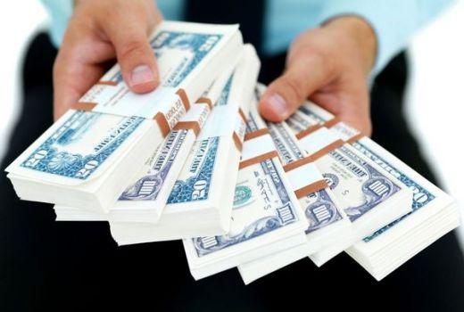 в долларах